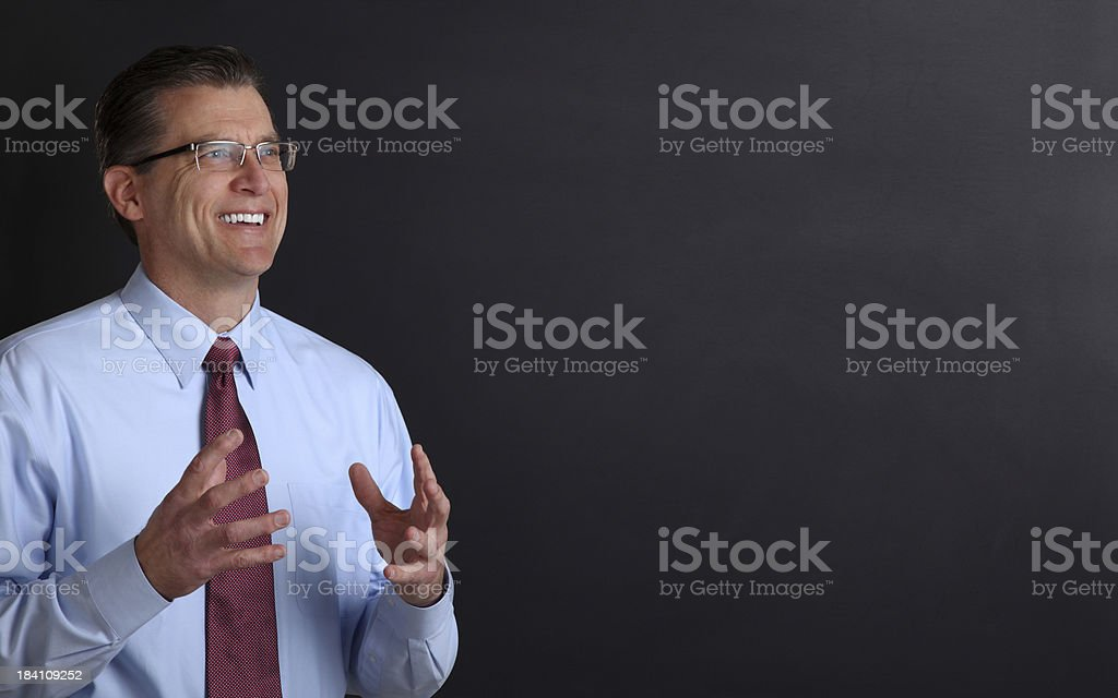 College Professor Against a Chalk Board royalty-free stock photo