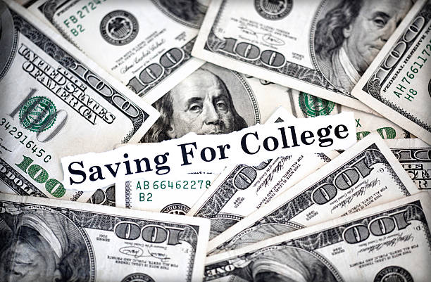 """college savings The words """"saving for college"""" with hundred dollar bills in background. ucla medical center stock pictures, royalty-free photos & images"""