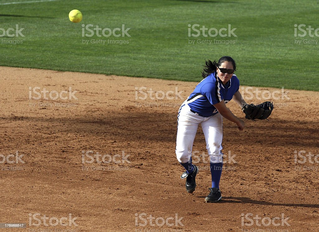 College Softball Player Throws Ball stock photo