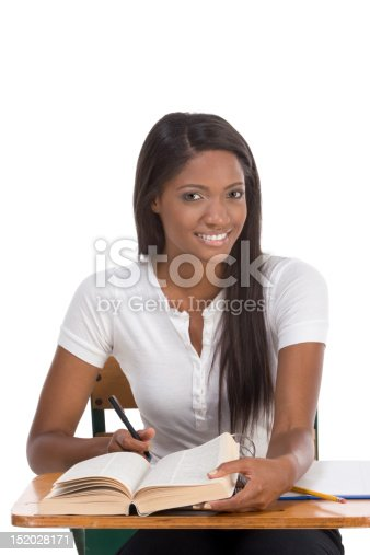istock College student African American woman by desk 152028171
