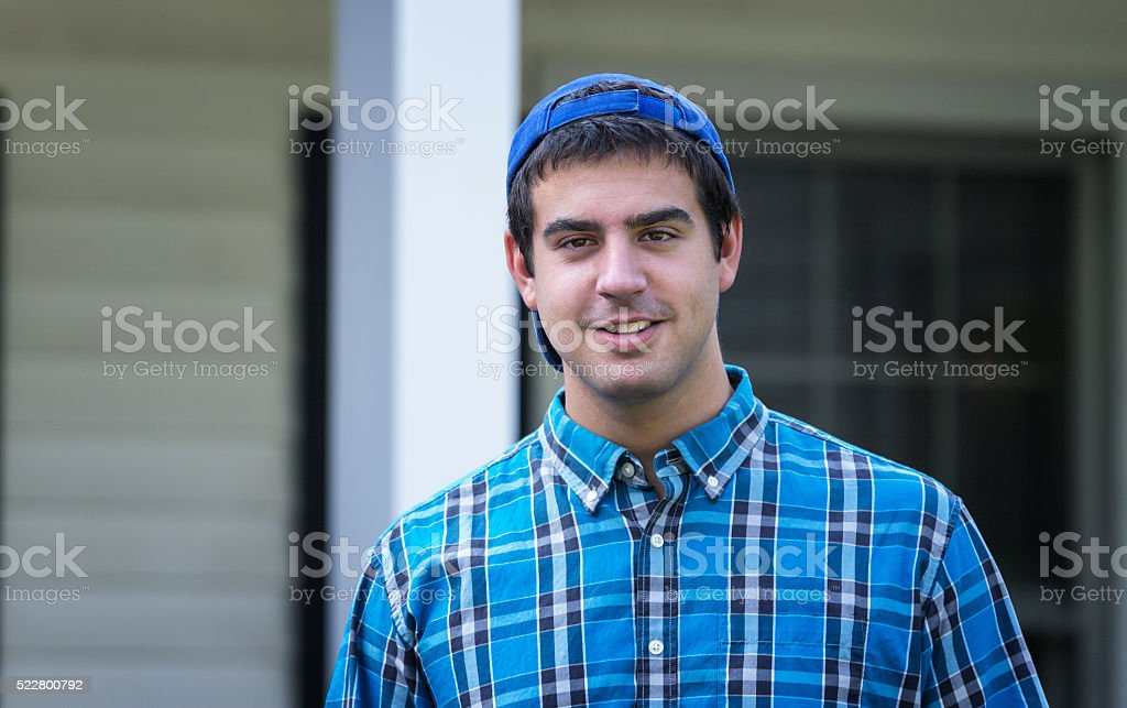 College Student Baseball Cap Backwards Young Man Portrait stock photo