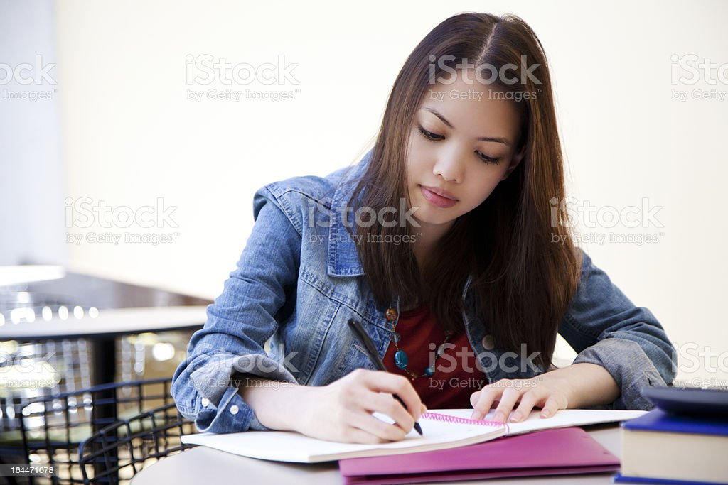 College student doing homework royalty-free stock photo