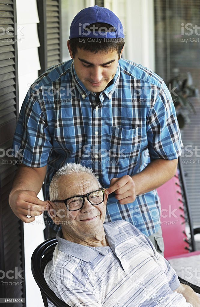 College Student Grandson Pulling Grandpa's Ears royalty-free stock photo