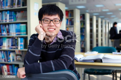 689644378istockphoto college student in library 172383945