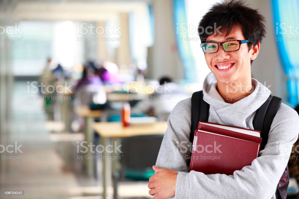 college student in the library stock photo