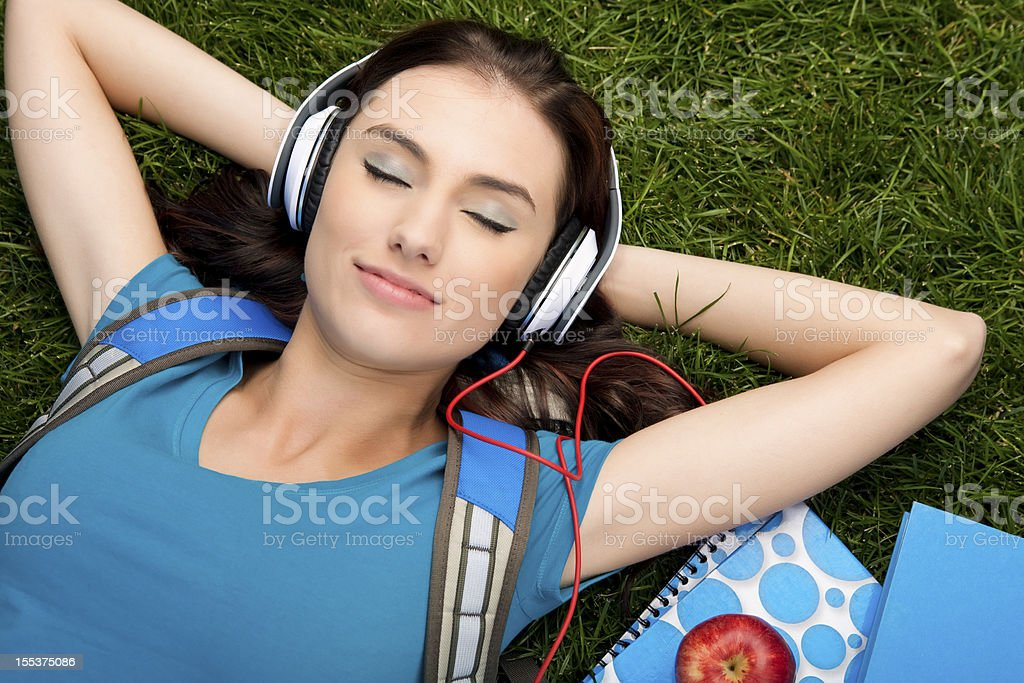 College student listening to music stock photo
