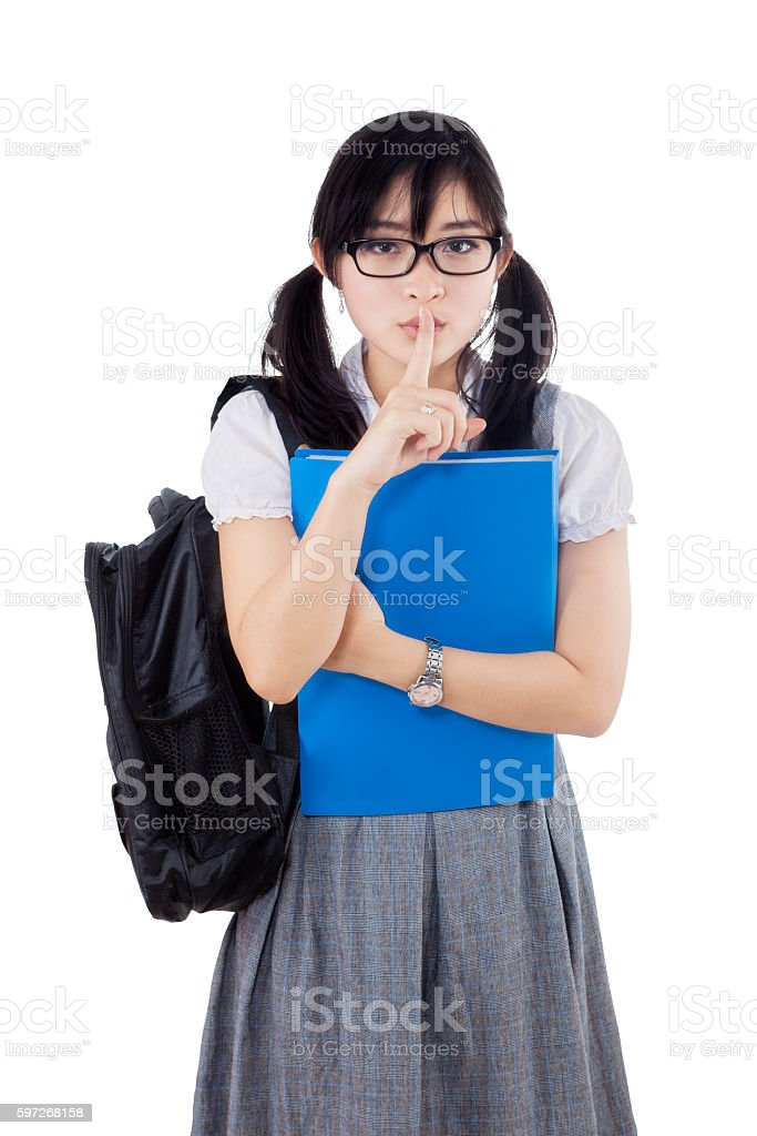 College student makes silence sign royalty-free stock photo
