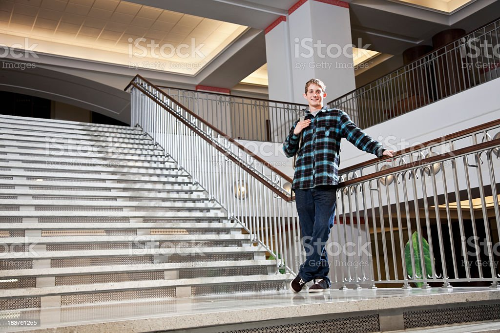 College student on steps of school building royalty-free stock photo