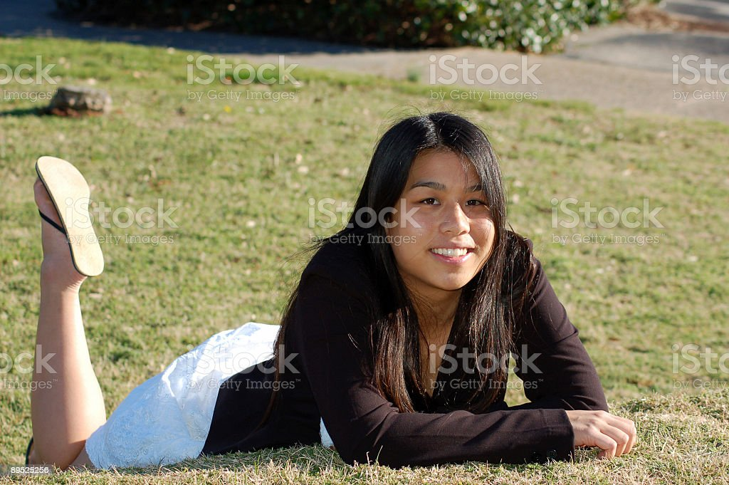 College Student on the grass stock photo