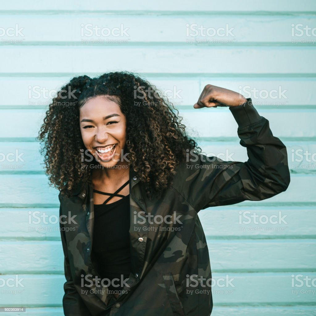 College Student Playfully Shows Strength stock photo