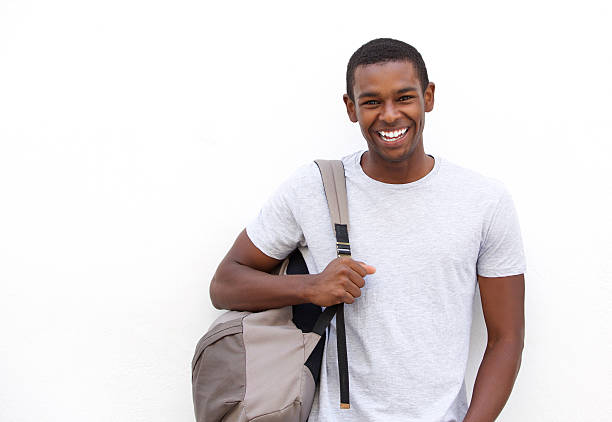 college student smiling with bag - student stock photos and pictures