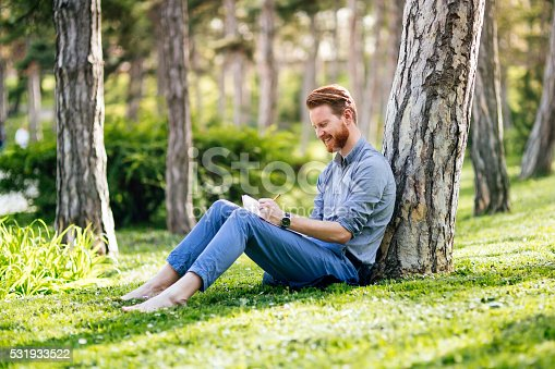 istock College student studying in park 531933522