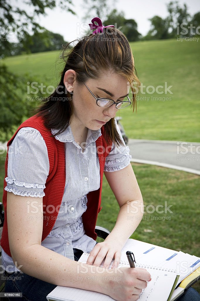 College Student Studying Outdoors royalty-free stock photo