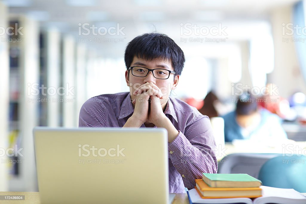 college student thinking about his future stock photo