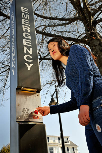 College Student Using Emergency Station stock photo