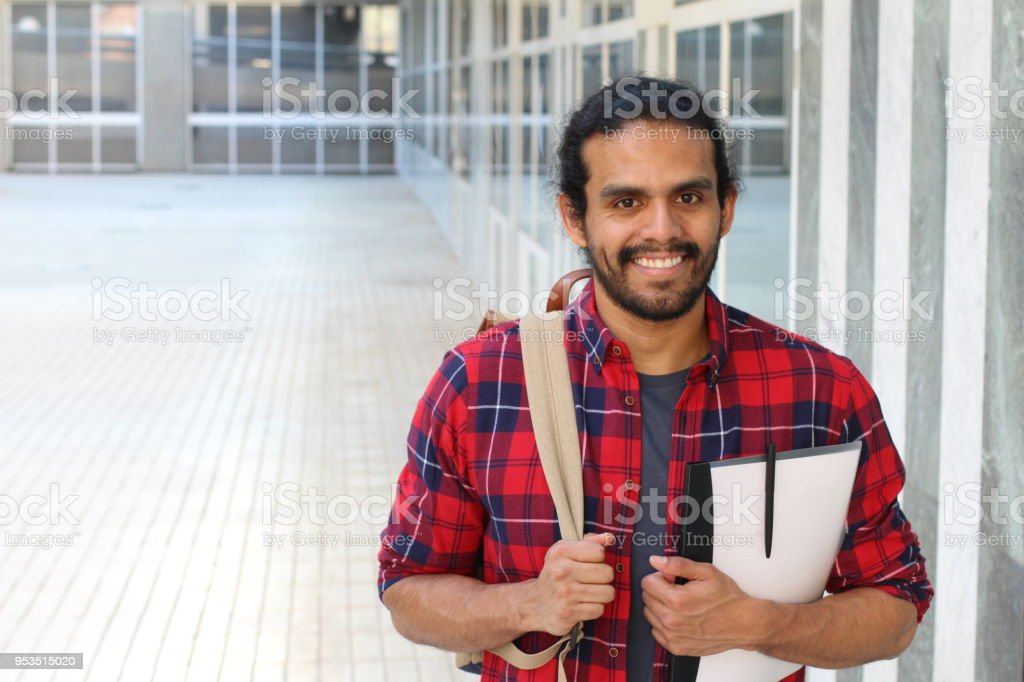 College student with backpack and books posing stock photo