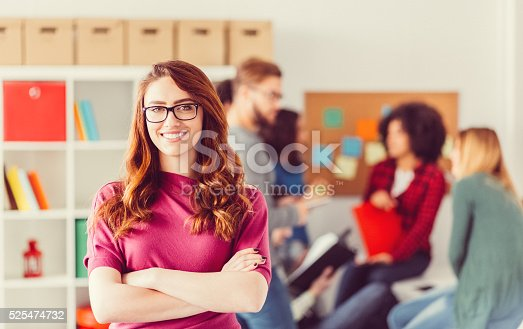 istock College student with crossed arms looking at camera 525474732