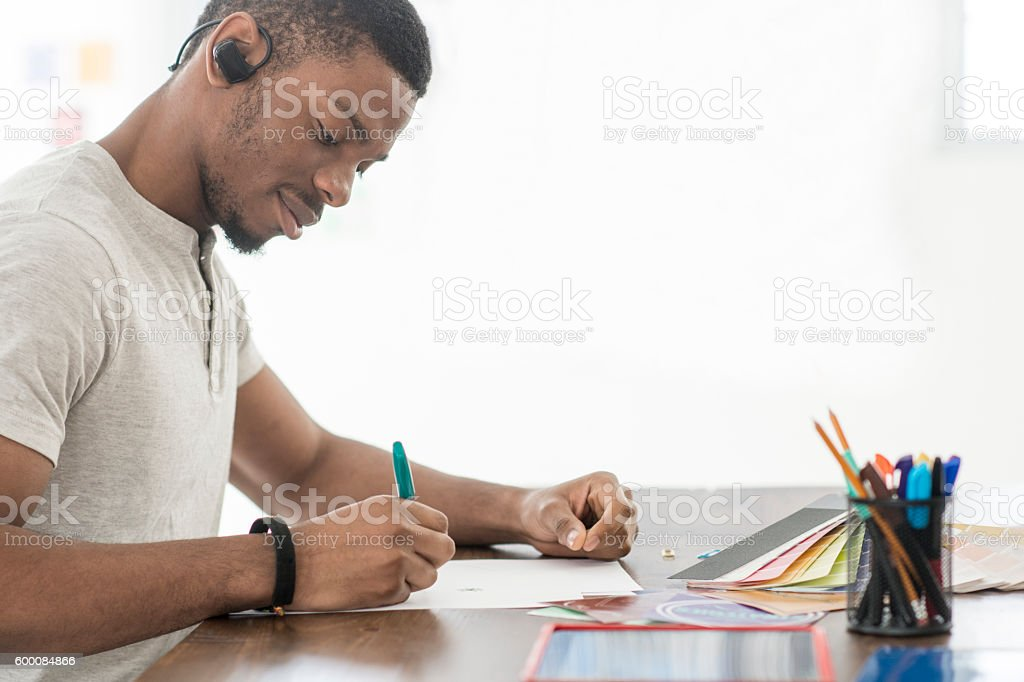 College Student Working on an Art Project stock photo