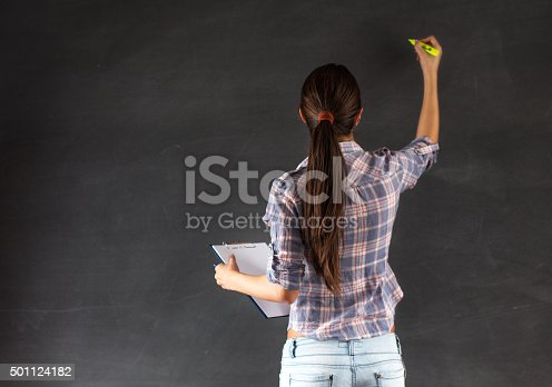 922759140 istock photo college student writing on the chalkboard 501124182