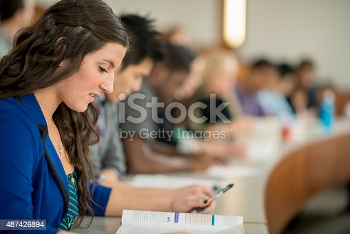 istock College Students Doing an Assignment in Class 487426894