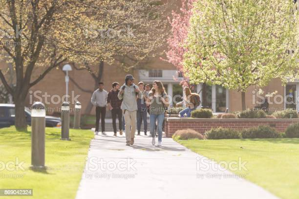 College students hang out in between classes on sidewalk talking and picture id869042324?b=1&k=6&m=869042324&s=612x612&h=f77s ayb1c8v97w36ce0 wvckgdl40tji 38ywq 9ry=