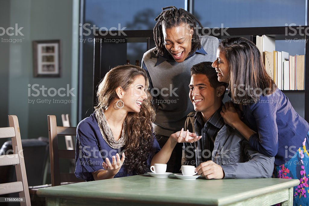 College students hanging out in coffee shop royalty-free stock photo