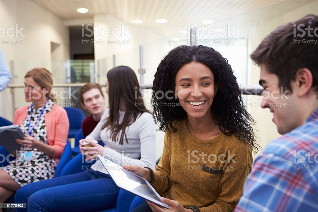 College Students Having Informal Meeting With Tutors stock photo