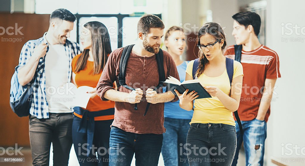 College students in a hallway. stock photo