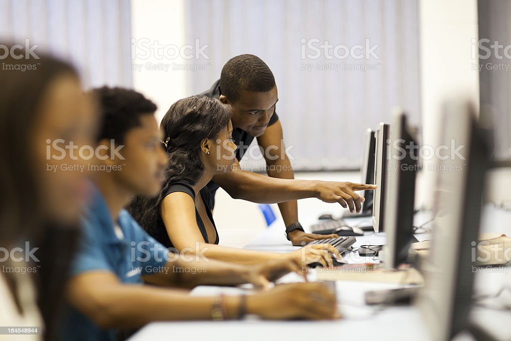 college students in computer room stock photo