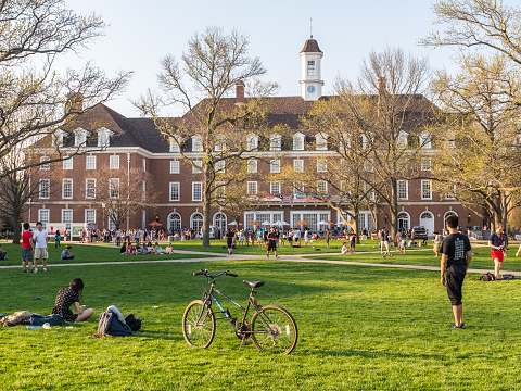Urbana, Illinois, April 17, 2016 - Students are out on the Quad lawn of the University of Illinois college campus in Urbana Champaign