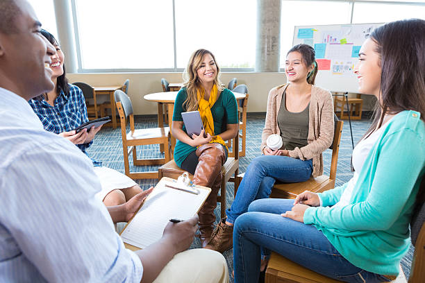 College students participate in support group stock photo