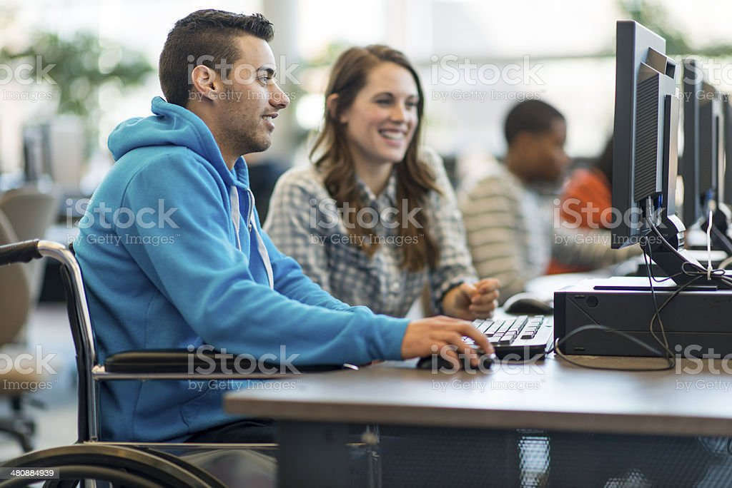 College Students Diverse college students working on computers. 20-29 Years Stock Photo