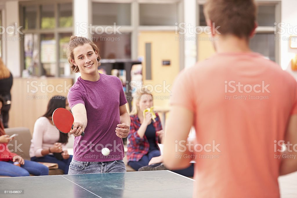 College Students Relaxing And Playing Table Tennis stock photo