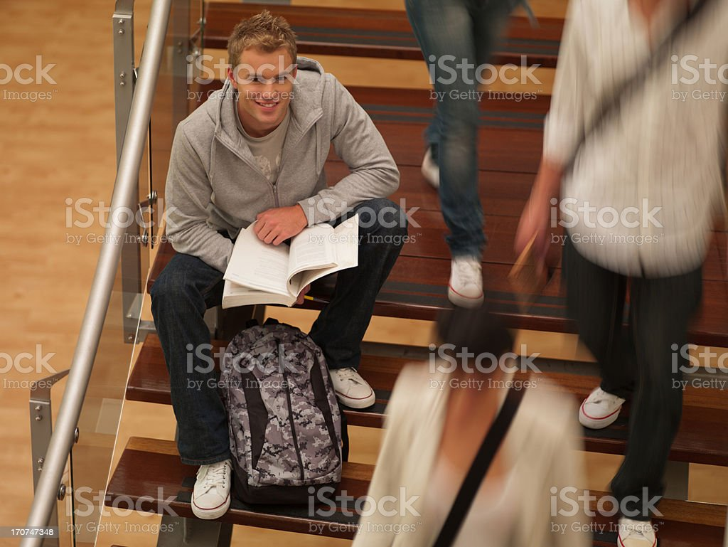 College students sitting on staircase royalty-free stock photo