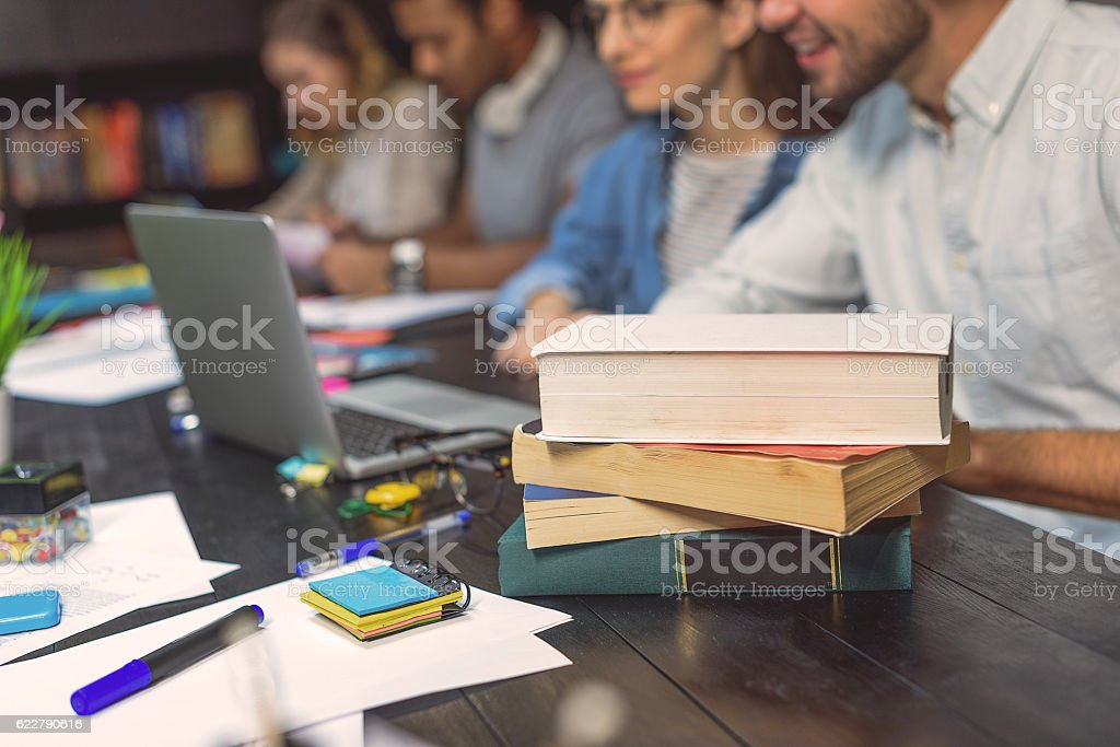 College students sitting together and studying stock photo