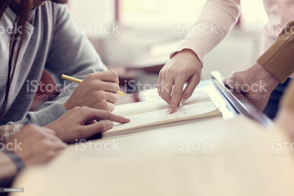 College students solving problem stock photo