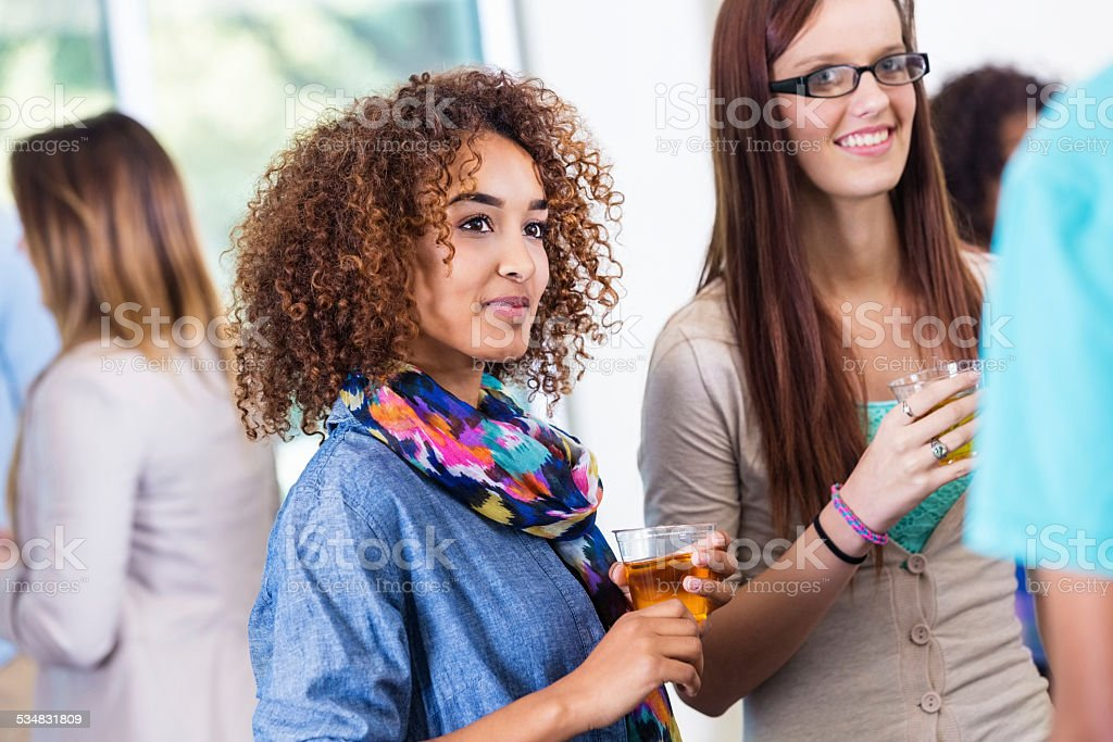 College students talking at sorority mixer or party stock photo