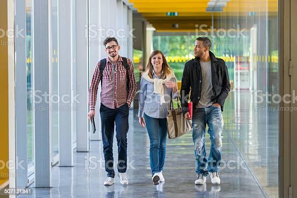 College students walking in the corridor picture id507121841?b=1&k=6&m=507121841&s=612x612&h=efmj6cnmhgkc62m 0onhbh0rkqaal6cjdrchbj4phly=