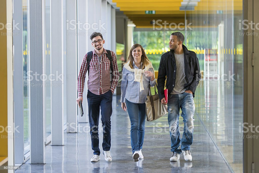College Students Walking In The Corridor stock photo