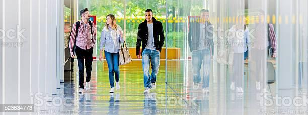 College students walking in the corridor picture id523634773?b=1&k=6&m=523634773&s=612x612&h=bn9hsgtyit4l duts1ihxxqjjhifyzl9qenp8zmbp1g=