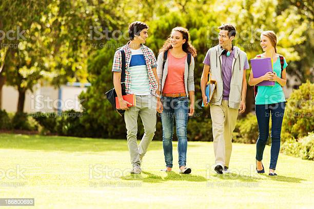 College students walking on campus lawn picture id186800693?b=1&k=6&m=186800693&s=612x612&h=xsmqwqu3u6wafi bfhvzm7b0dl8 zox0se9g6y37to4=