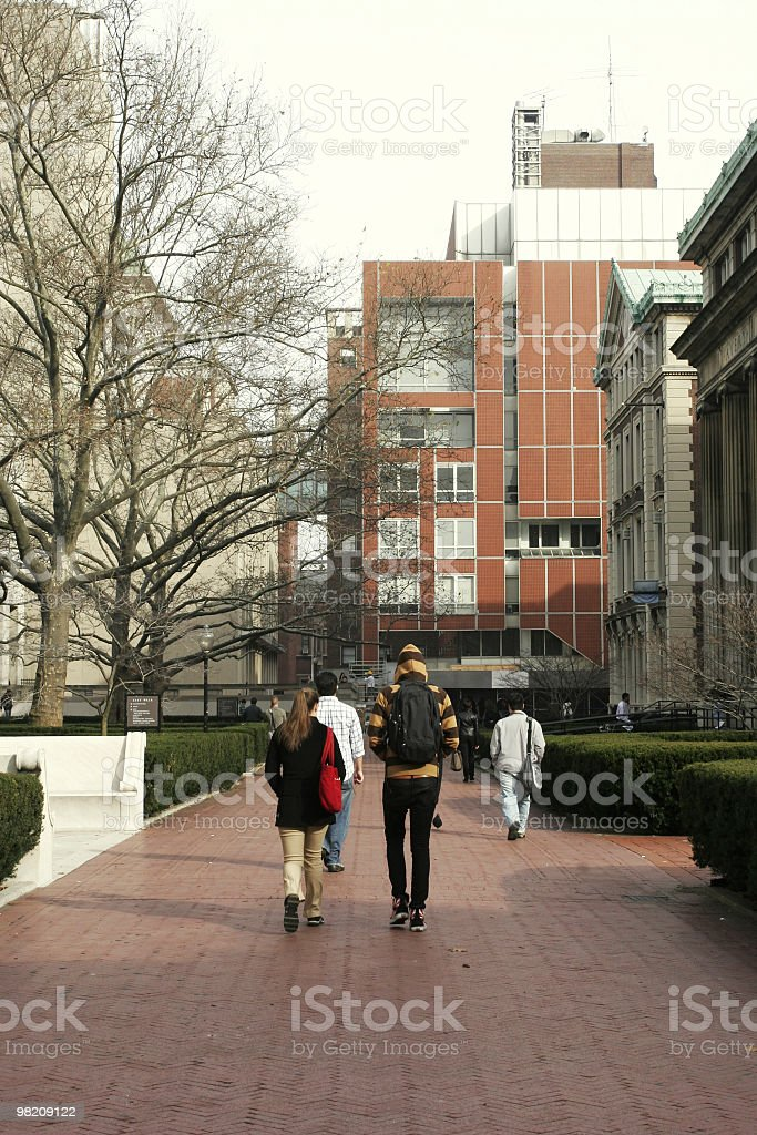 College students walking on campus royalty-free stock photo