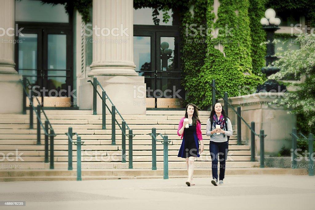 College Students Walking on School Campus Horizontal stock photo