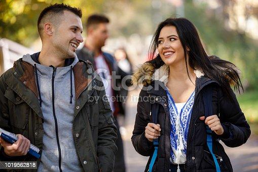 824257318 istock photo College students walking on university campus 1019562818