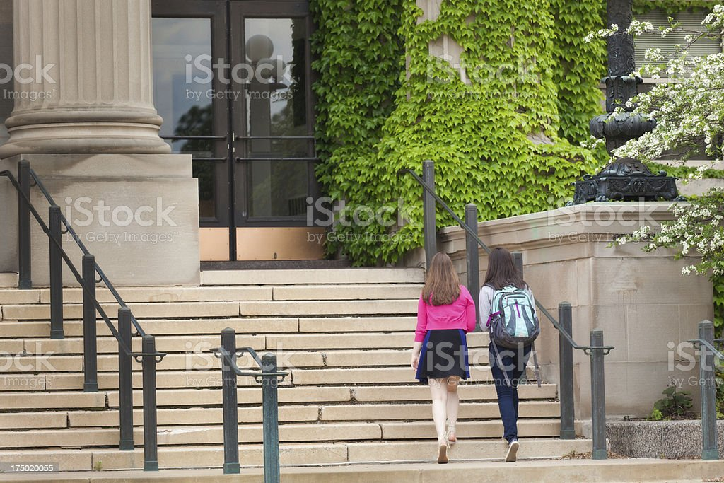 College Students Walking Up School Steps to Campus Class Horizontal stock photo