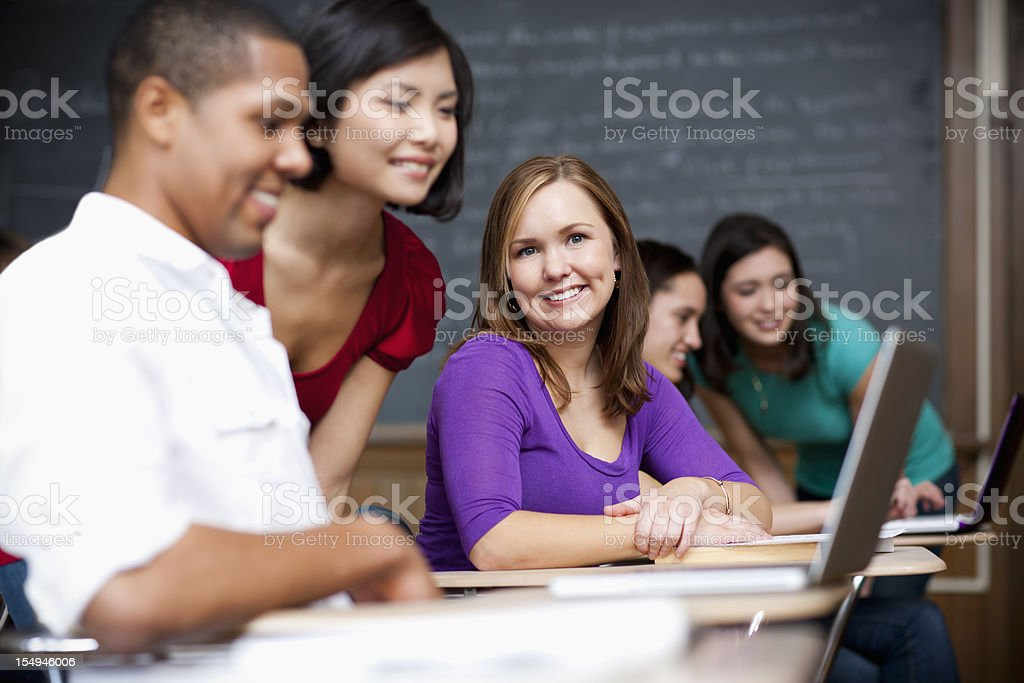 College students with laptops on classroom royalty-free stock photo