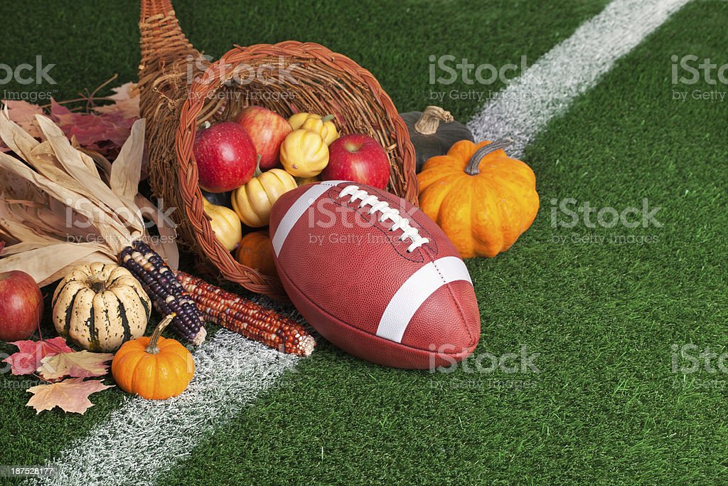 College style Football with a cornucopia on grass field stock photo
