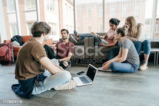 A group of students working on their thesis