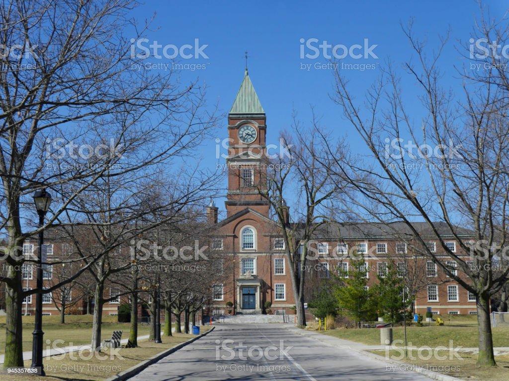 college with clocktower stock photo
