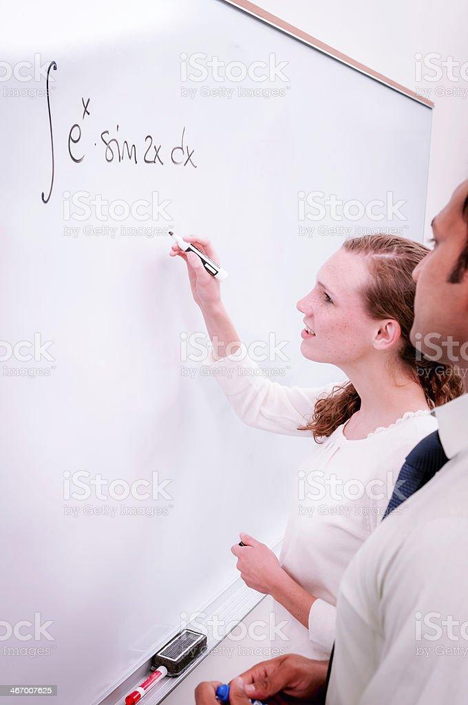 College/university students solving math problem - VI royalty-free stock photo